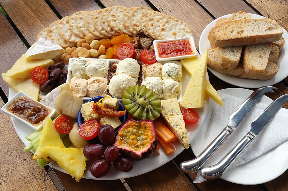 colourful cheese-platter with fruit and nuts