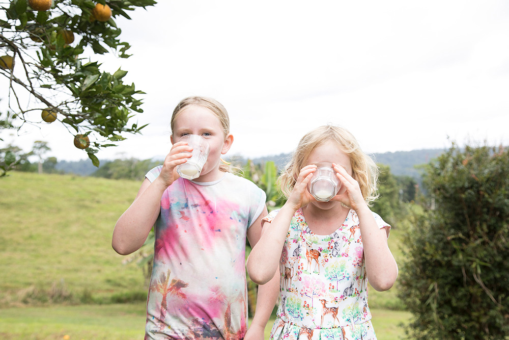 two sisters drinking milk