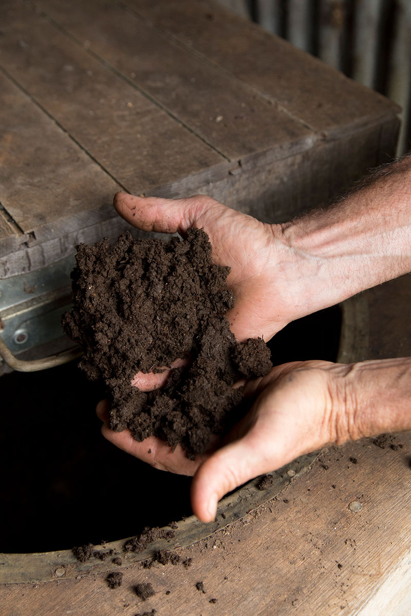 a-farmer-holding-biodynamic-compost-in-his-hands